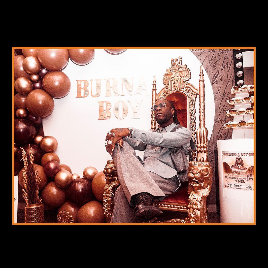 Burna Boy Sitting