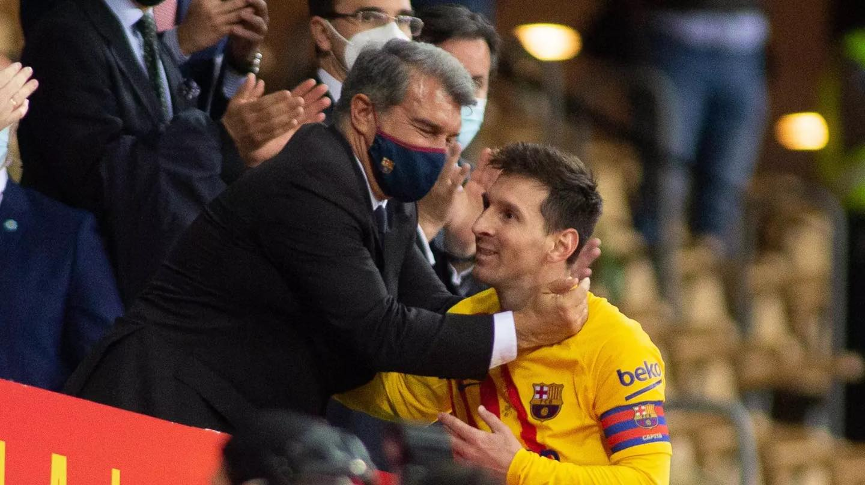 Barca president Laporta and Messi